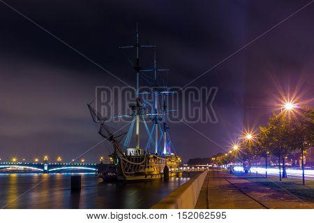 Frigate Grace at twilight illumination, St. Petersburg, Russia
