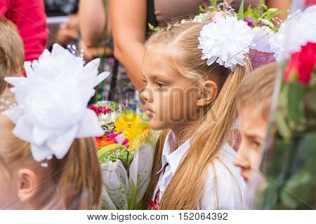 First Grader Standing In A Crowd Of Children On Line The First Of September