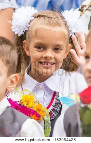 First Grader On The First Of September, The Line Greeting Waving Friend