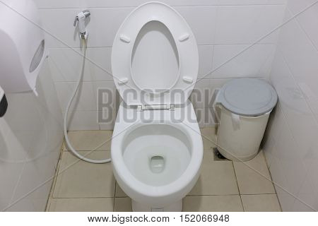 Modern Toilet bowl in a men bathroomwhite ceramic flush toilet for men in toilet room.