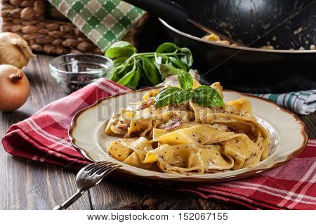 Pappardelle Pasta With Prosciutto And Cheese Sauce On A Plate
