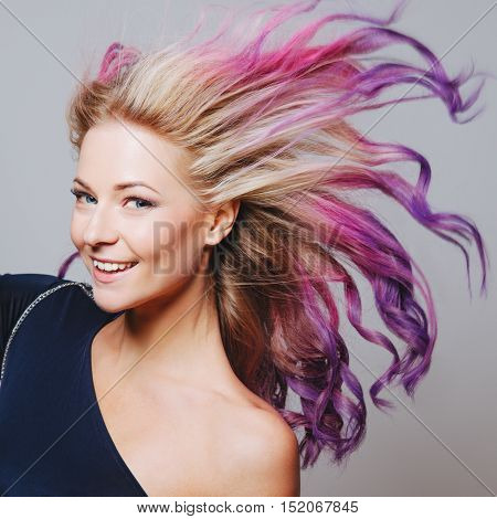 Colored hairs. Portrait of smiling women with flying hairs. Ombre. Gradient