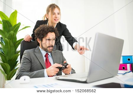 Employee playing videogames at work