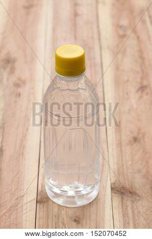 Plastic of Water bottles on wooden floor.