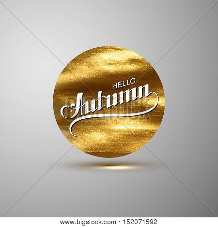 Hello Autumn. Seasonal vector illustration of handwritten label on golden paint stain banner. Vector gold paint. Autumn lettering composition with gold glittering textured stain.