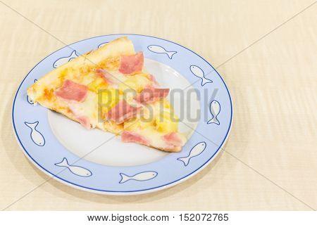 Pizza hawaiian sliced with ham and pineapple