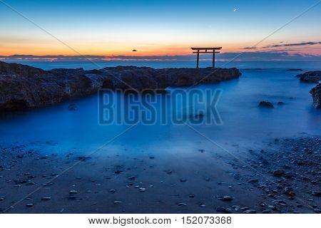Toroii Japanese shrine gate sunrise at sea Oarai city , Ibaraki Japan
