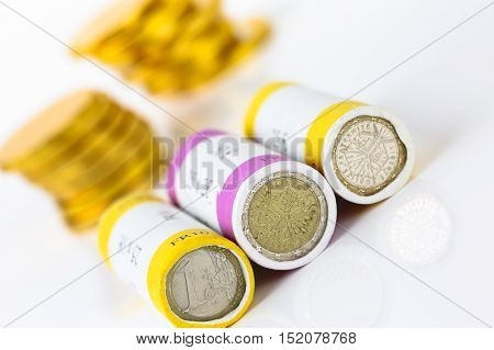 close up on euro notes and roll coins