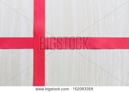 Red ribbons on a wooden background and have clipping paths to easy deployment.