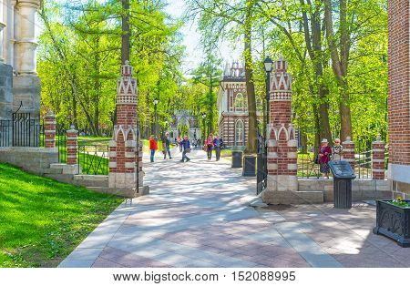 MOSCOW RUSSIA - MAY 10 2015: The shady alley in Tsaritsyno Royal Estate leads to the Small Palace (Semicircular Palace) through the scenic gate on May 10 in Moscow.