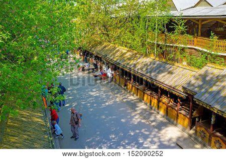MOSCOW RUSSIA - MAY 10 2015: The wooden multi-store galleries of the flea market in Izmailovo on May 10 in Moscow.