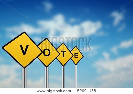 vote on yellow road sign with blurred sky background