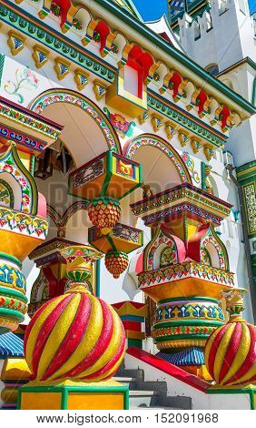 The splendid porch of the traditional Russian style church in Izmailovsky Kremlin with complex decors figured pillars covered with floral patterns Moscow Russia.