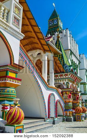 The porch at the outer side of Izmailovsky Kremlin decorated with the bright towers painted pillars and zig-zag balls imitating the onion domes typical for the medieval Russian religious architecture Moscow Russia.