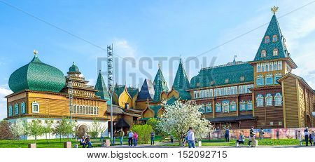 MOSCOW RUSSIA - MAY 10 2015: The wooden Palace of Tsar Alexei Mikhailovich in Kolomenskoye decorated with bright green dome and various towers on May 10 in Moscow.