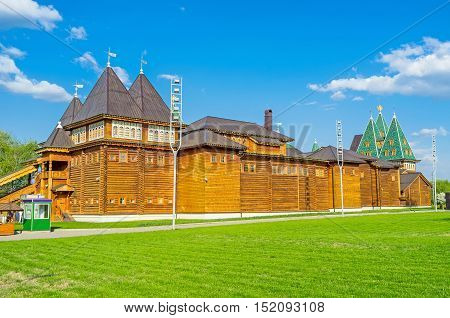 The back side of the timbered Grand Palace of Tsar Alexei Mikhailovich in Kolomenskoye Manor with the green lawn on the foreground Moscow Russia.
