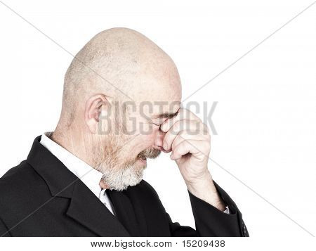 Mourning old man with a grey beard