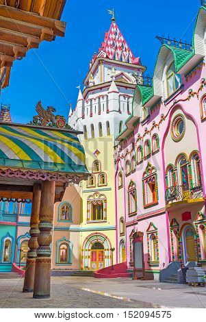 The colorful mansions of art galleries souvenir stores and restaurants with the tower in corner Izmailovsky Kremlin Russia.