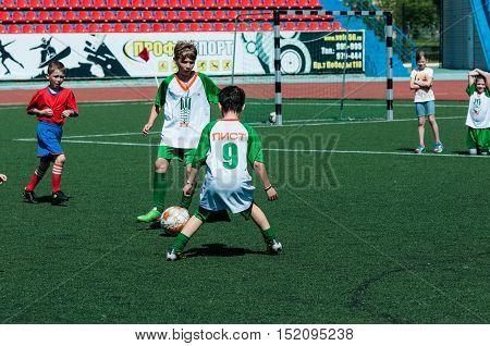 Orenburg, Russia - 31 May 2015: Boys And Girls Play Soccer