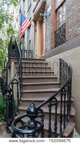 An American flag on a traditional house porch in Savannah