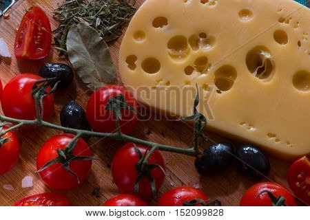 Emmental With Tomatoes And Basil On Wood