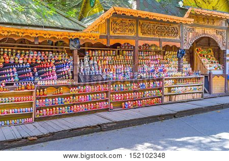 MOSCOW RUSSIA - MAY 10 2015: The carved stalls with wide range of traditional wooden painted matryoshka dolls the world known symbol of the country on May 10 in Moscow.