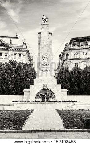 Soviet war memorial in Budapest Hungary. Cultural heritage. Architectural theme. Historical object. Travel destination. Memorial place. Black and white photo. Memorial green trees and old buildings.