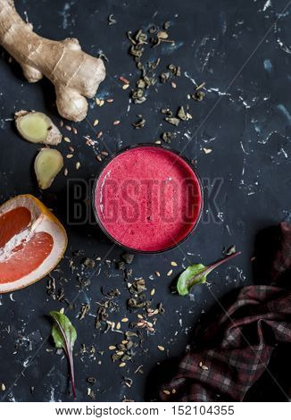 Beet and Ginger Detox Elixir. On a dark background top view