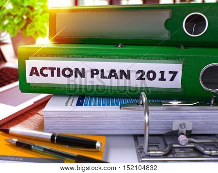 Green Office Folder with Inscription Action Plan 2017 on Office Desktop with Office Supplies and Modern Laptop. Action Plan 2017 Business Concept on Blurred Background. 3D Render.