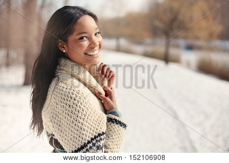 Girl walking around in a snow filled park