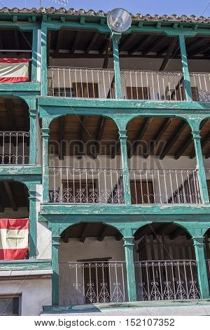 Chinchon Spain - October 15 2016: Detail of balconies typical of the century XIX located in Main square Touristic village in Madrid province Chinchon Spain