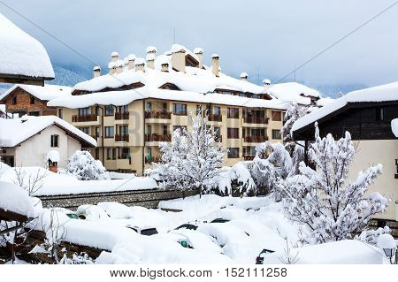 Snow covered chalets after the very hard snowfall