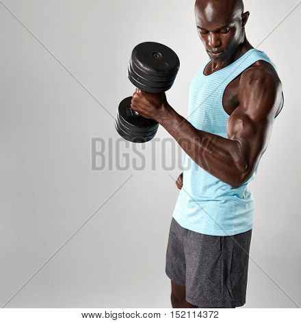 Bodybuilder Using Heavy Dumbbell