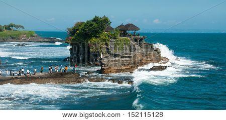 Pilgrimage temple Pura Tanah Lot in Bali Island