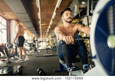 Ripped bodybuilder man working out in gym