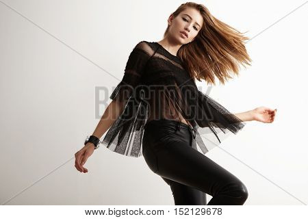 Beauty Dancing Caucasian Woman In White Studio In Rock Style Clothes
