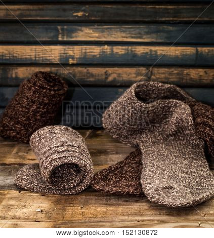 Warm Knitted Socks On Wooden Background