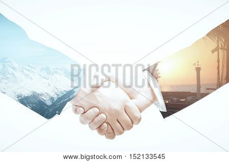 Closeup of businessmen shaking hands on abstract landscape background. Business abroad concept. Double exposure