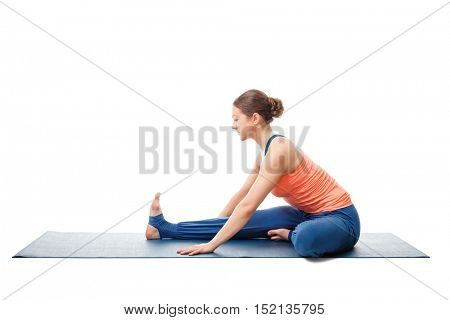 Young beautiful sporty fit woman doing Ashtanga Vinyasa Yoga asana Janu sirsasana A - head-to-knee pose A posture beginner variation isolated on white