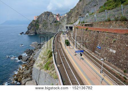 Manarola Italy - September 4 2016: Railway station in Manarola city in Liguria Italy. One of five Cinque Terre cities (unesco world heritage). Unidentified people visible.