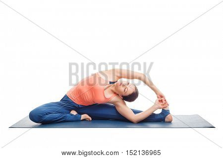 Beautiful sporty fit yogini woman practices yoga asana parivrtta janu sirsasana - revolved head-to-knee pose isolated on white background