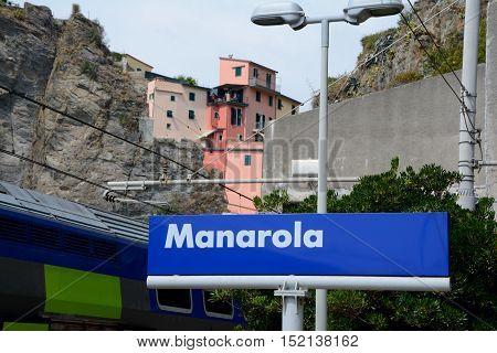 Manarola Italy - September 4 2016: Manarola information board on railway station. One of five Cinque Terre cities (unesco world heritage). Unidentified people visible.