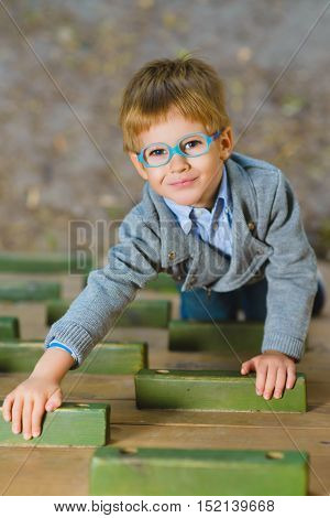 Young boy playing when having fun doing activities outdoors. Happy childhood concept.
