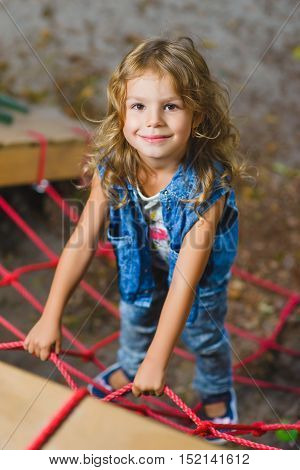 Young girl playing when having fun doing activities outdoors. Happy childhood concept.