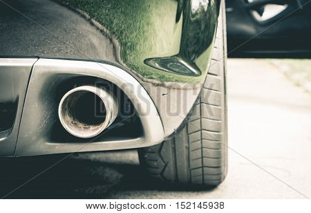 Luxury Sport car muffler on the right hand side.