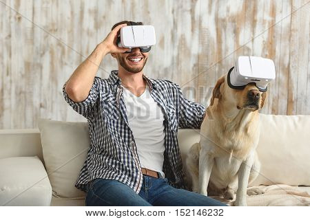 virtual reality for all, a man with his puppy in VR headset, friends concept