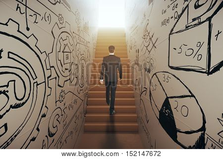 Back view of young businessman in suit climbing abstract narrow ladder with business sketches leading to bright light. Success concept. 3D Rendering
