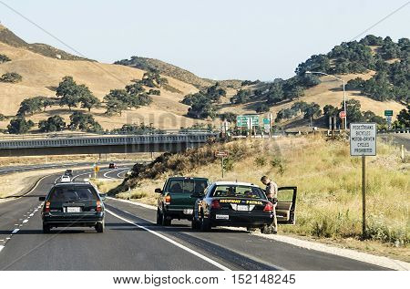LOS ANGELES USA - JULY 29 2008: highway patrol stops a car for speeding on Highway 101.