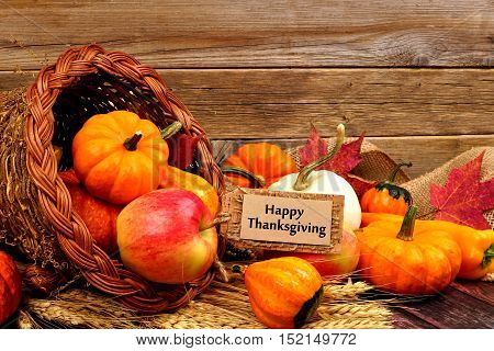 Happy Thanksgiving Tag And Cornucopia With Autumn Fruit And Vegetables On Rustic Wood Background
