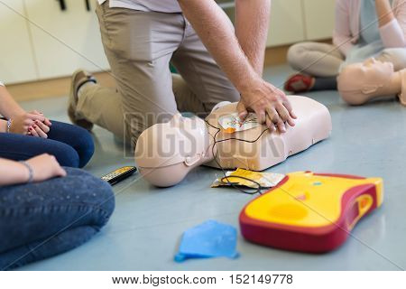 First aid cardiopulmonary resuscitation course using automated external defibrillator device, AED. poster